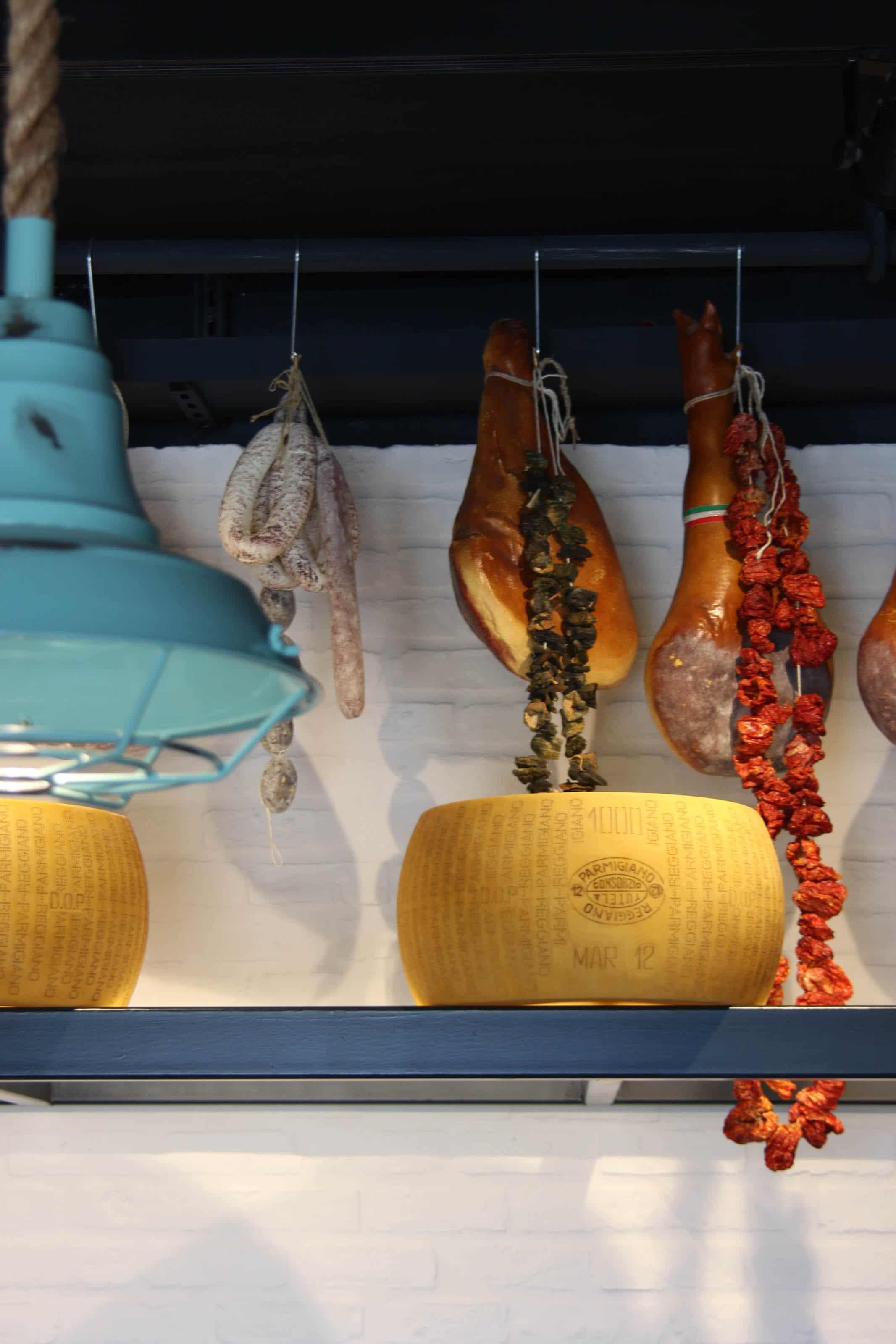 Deli with authentic Parmesan and prosciutto crudo.
