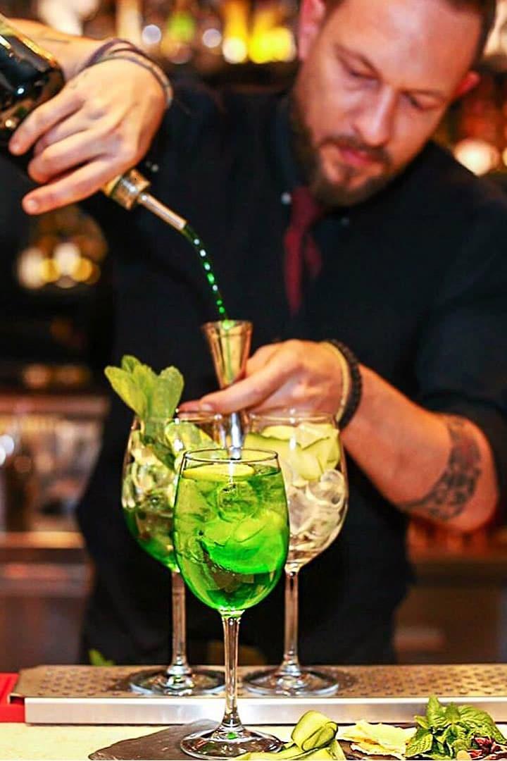 Bartender preparing aperitivo in Mykonos